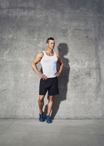 Full body fitness portrait of muscular man