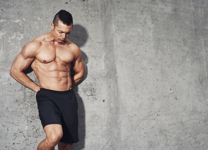 Male fitness model with abdominal muscles