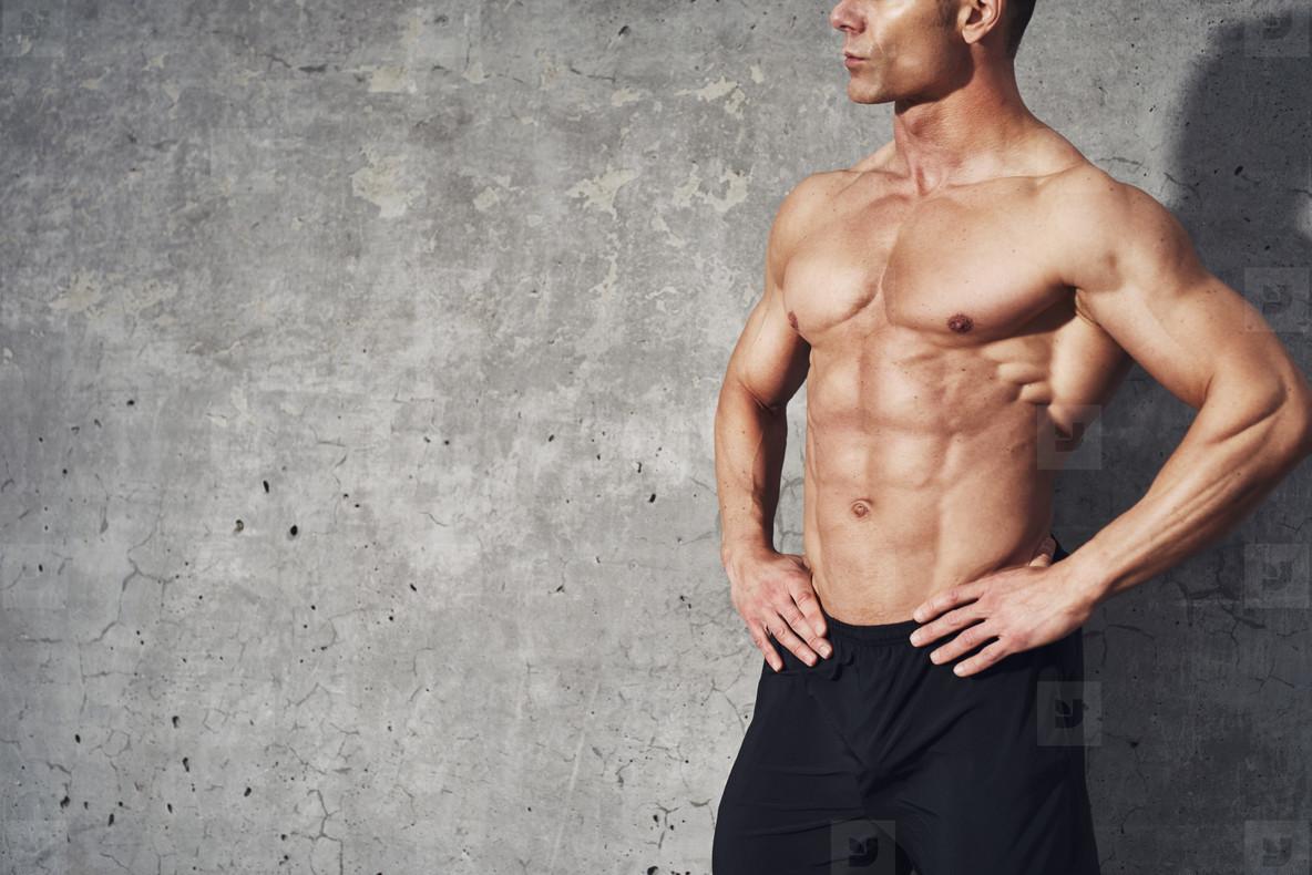 Photos - Muscular fitness model, male half body man no shirt ...