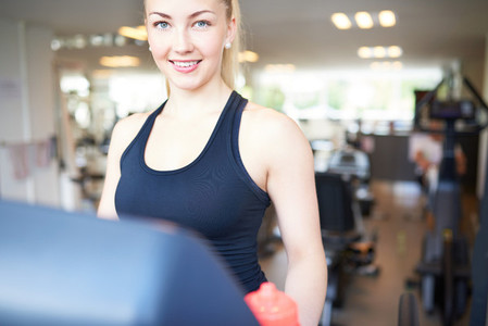 Pretty Young Woman Exercising Inside Fitness Gym