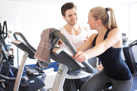 Fitness Trainer Talking to a Woman Inside the Gym