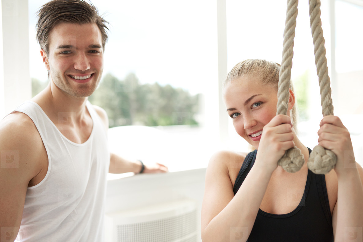 Woman with her Personal Trainer Smiling at Camera