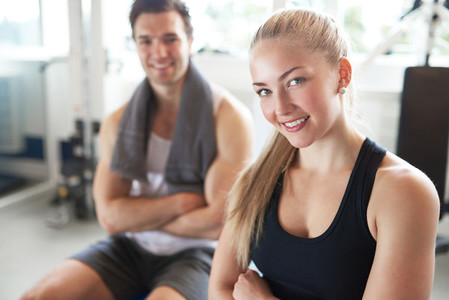 Portrait of Confident Woman and Man in Gym