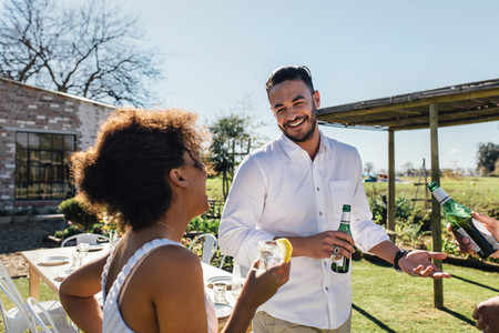 Man having a party with friends in garden