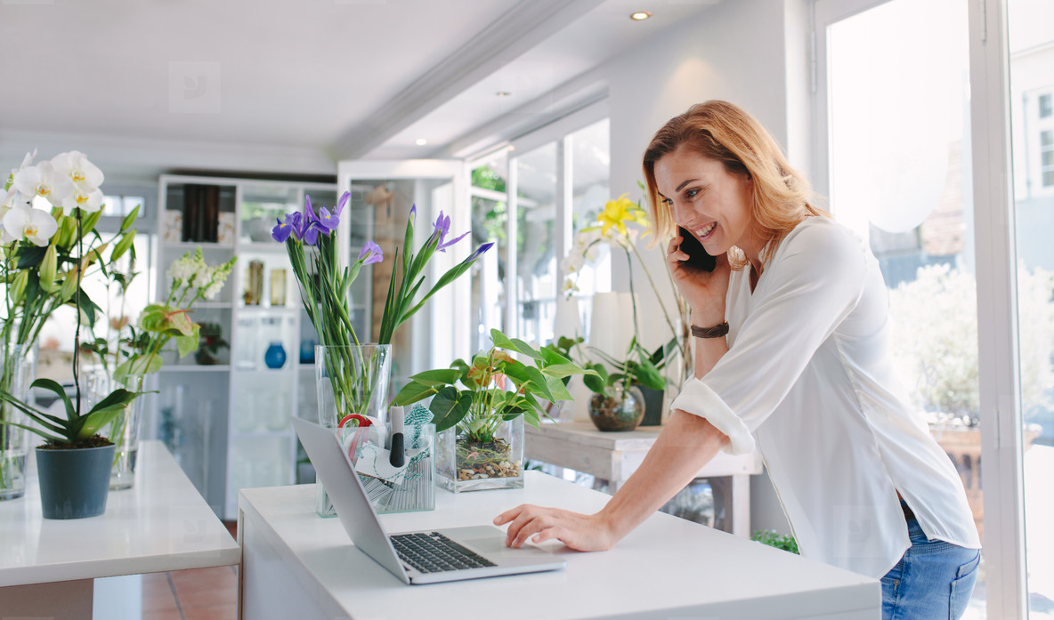 Florist taking order on mobile phone