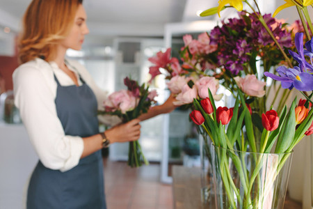 Floral design studio with florist in background