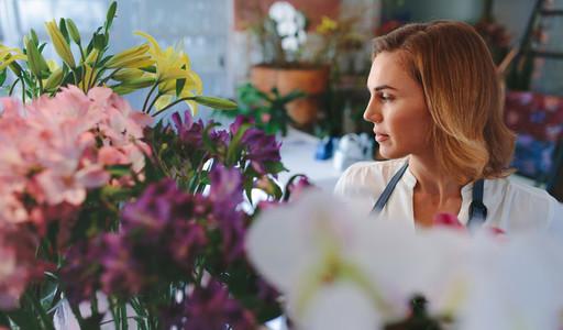 Woman working in flower shop