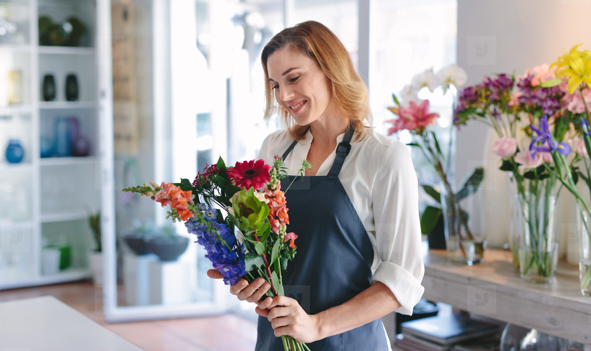 Florist creating bouquet at her shop