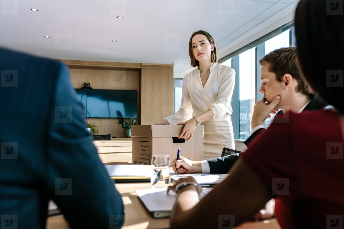 Business professionals brainstorming in office board room