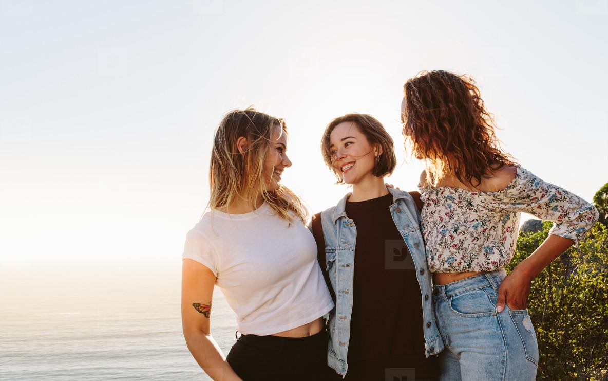 Smiling female friends enjoying on summer vacation