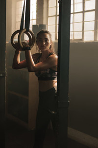 Woman working out on gymnast rings