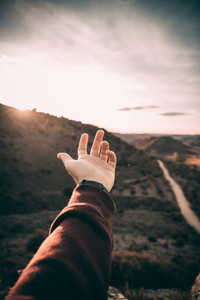 Hand in a sunset