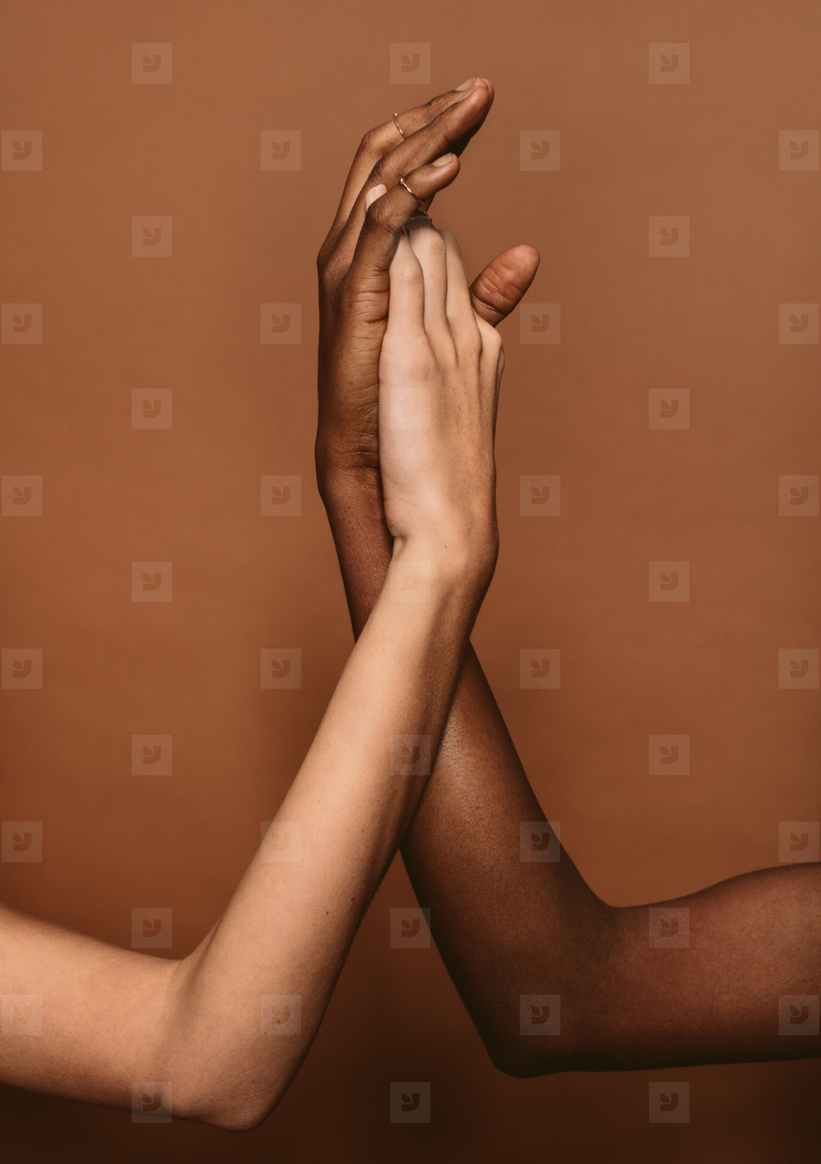 Diverse females putting hands together
