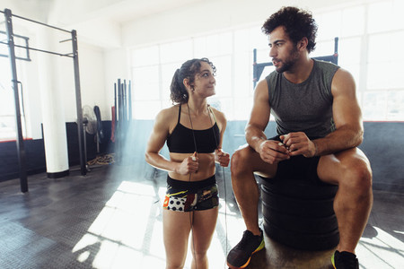 Fitness couple taking a break after physical training