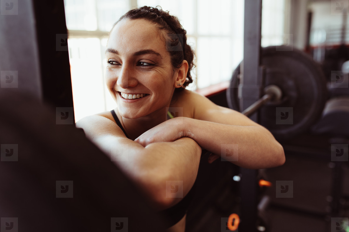 Female taking rest after intense training in gym
