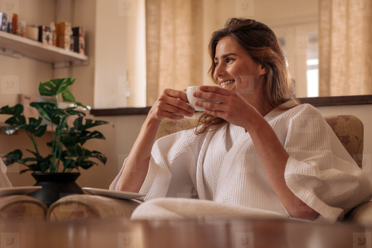 Woman having coffee and relaxing at spa salon