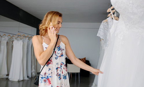 Bride on phone shopping for wedding dress