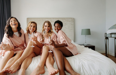 Bride and bridesmaids celebrating bachelorette party