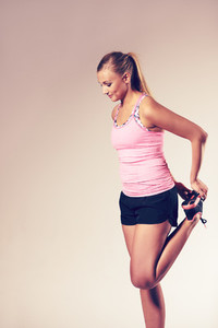 Woman standing and stretching out leg muscles