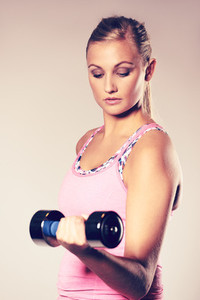 Woman looking down at weight doing bicep curl