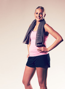 Woman posing with hand on hip wearing workout clothes