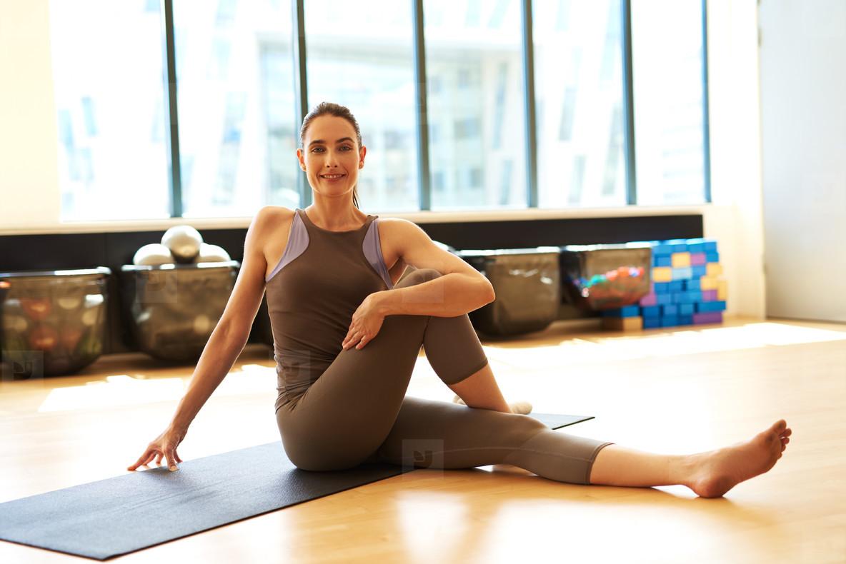 Good looking woman doing pilates