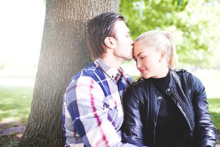Loving couple enjoying a tender kiss