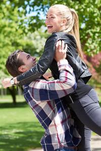 Happy fun loving couple in a park