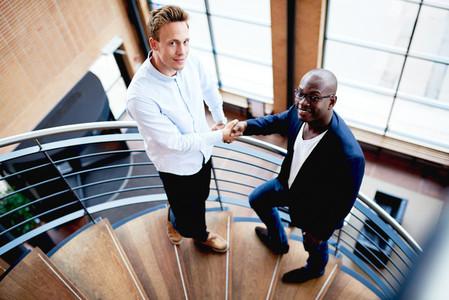 Black man and white man shaking hands