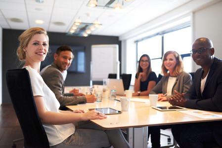 Group of young executives smiling at camera
