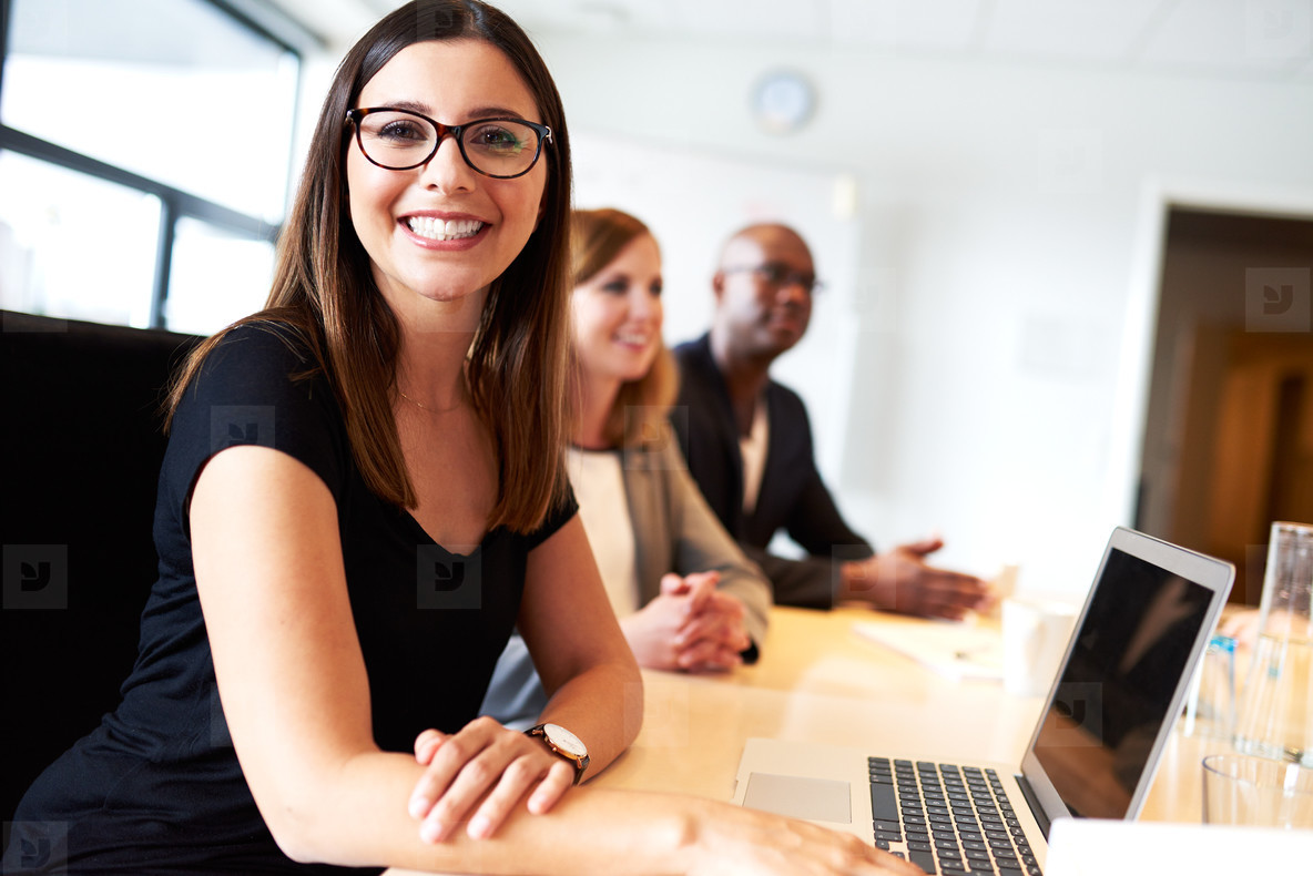 Young female executive smiling during meeting