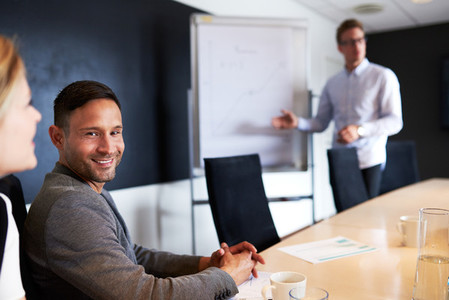 White male executive smiling and facing camera