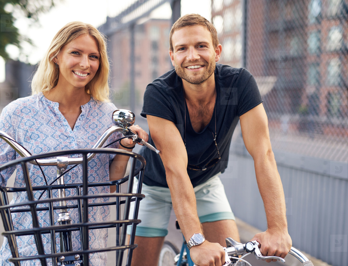 Fit young couple out enjoying a day cycling