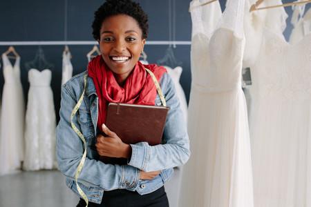 Female wedding fashion designer in a bridal boutique