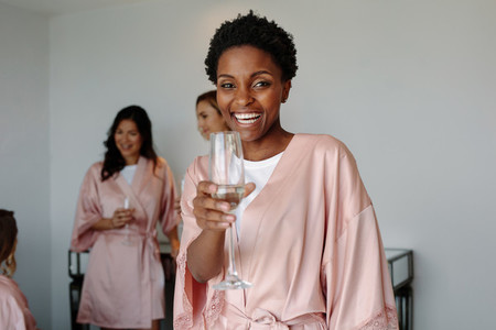 Cheerful woman at bachelorette party of a friend
