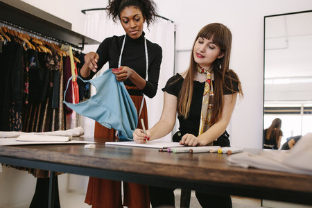 Woman entrepreneurs at work in their fashion studio
