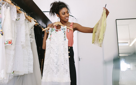 Woman entrepreneur at work in her fashion boutique