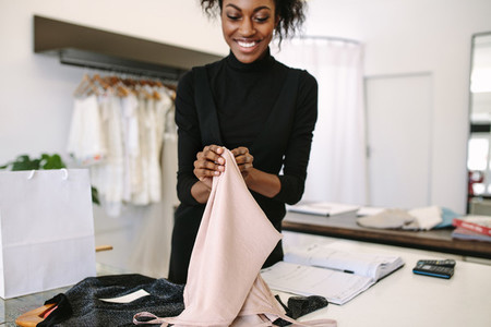 Woman entrepreneur at work in her fashion studio