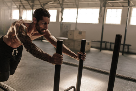 Man doing intense workout in gym