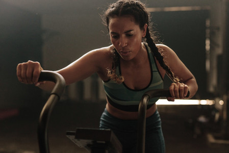 Woman using exercise bike at the gym