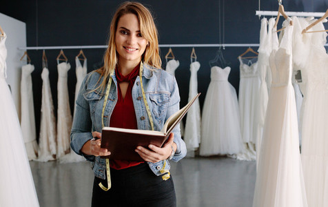 Woman working in bridal boutique