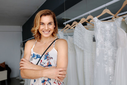 Beautiful young bride in a bridal boutique