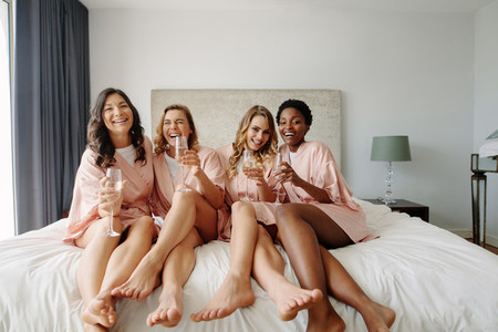 Women having a bachelorette party at hotel room