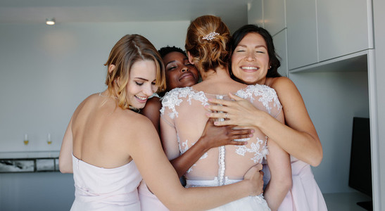 Bridesmaids congratulating the bride on wedding day