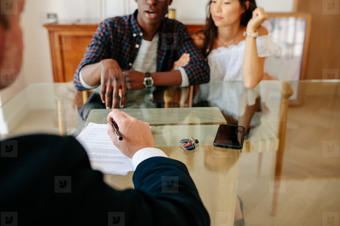 Couple and estate agent discussing during a property deal
