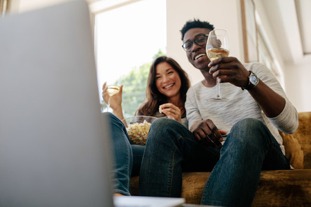 Couple enjoying free time at home watching movie