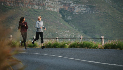 Sports women running in the morning