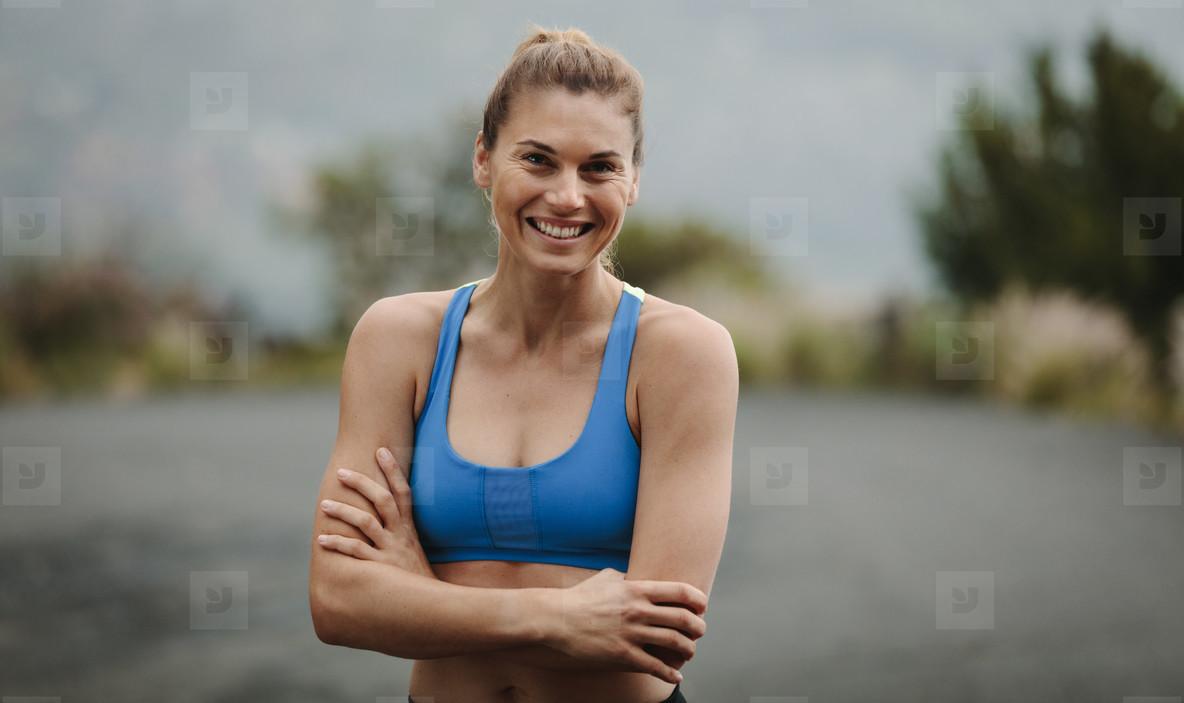 Woman athlete on road