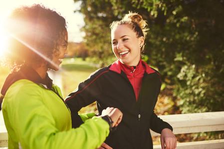 Smiling sportswomen standing outdoors