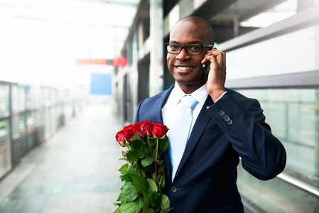 African American holding a bouquet of roses